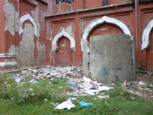 A rubbish bin, and several crumbling arches